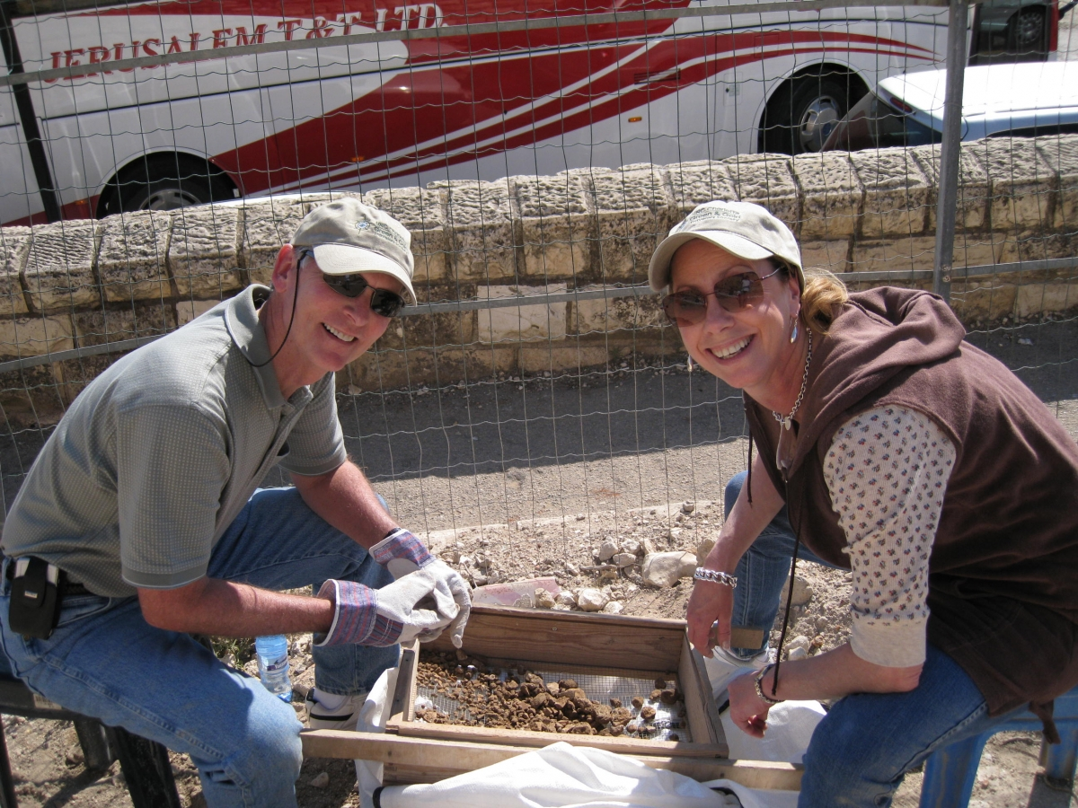 Chancellor Philip Dubois and his wife, Lisa, sift for artifacts at Mt. Zion Dig